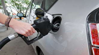 Hybrid Car At The Pump