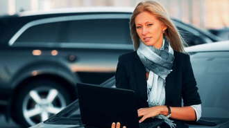 Woman At Car Dealer