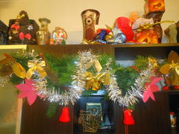 My decorated garland hanging on the closed bookcase in my living room
