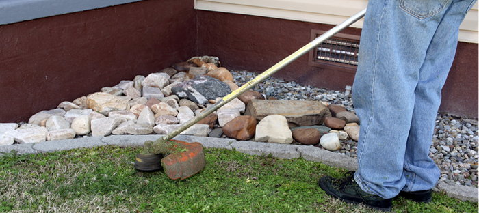 man edging lawn and garden bed