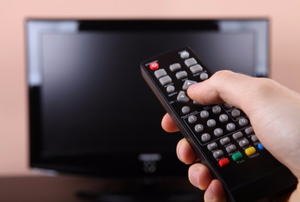 using the remote to operate the television
