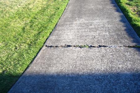 How To Repair A Cracked Sidewalk Doityourself Com