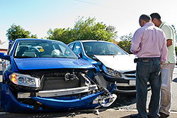 Men discussing car accident