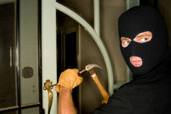 Burglar trying to get into a home