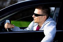 Man in sunglasses driving
