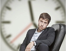 Sad Man with Clock in Background