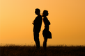 silhouettes of couple back to back