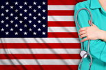 nurse standing in front of flag