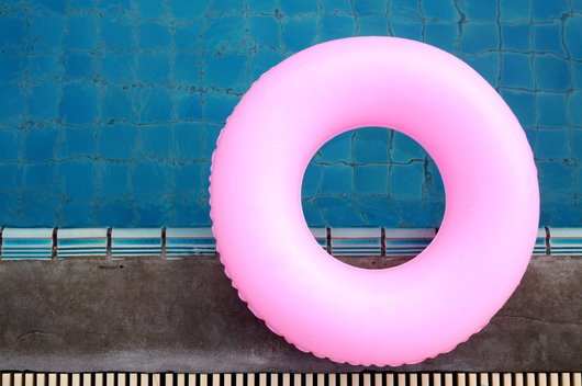 bright pink swimming pool float