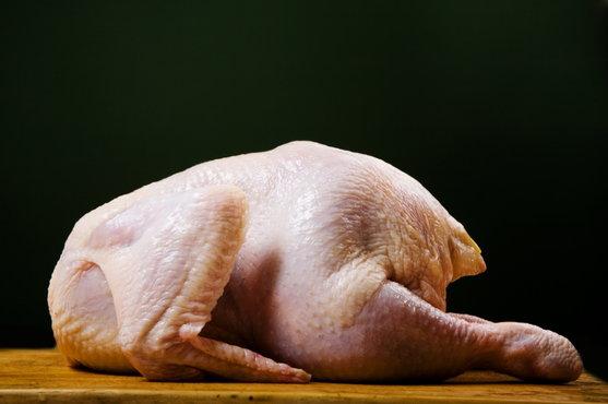 raw turkey on cutting board