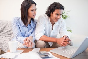 couple budgeting on computer