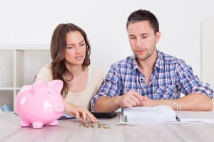 couple looking at their finances, calculate budget