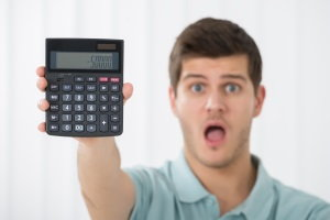 shocked man with calculator