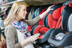 mom choosing children car seat, mom looking at kid car seats