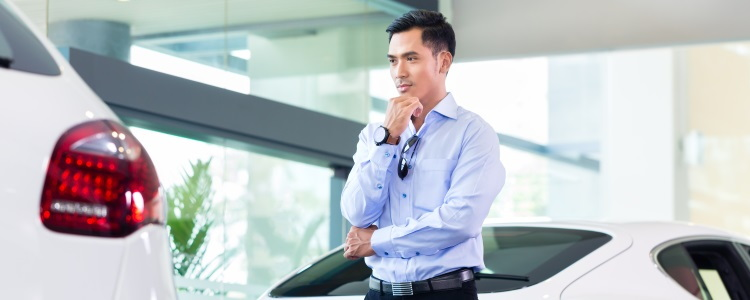 man looking at a car, man at dealership, car shopping