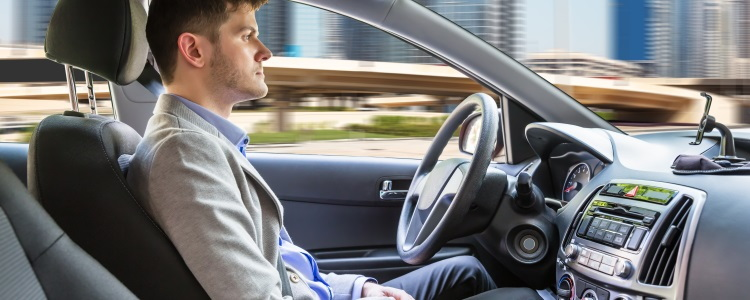 man sitting in self-driving car, autonomous car