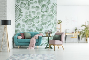 Living room with aqua couch and pink chair