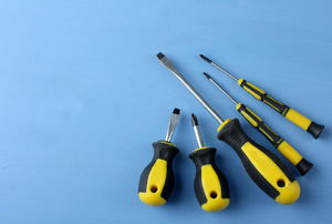 A set of screwdrivers against a blue background.