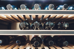 wine bottles in an upcycled refrigerator wine cellar