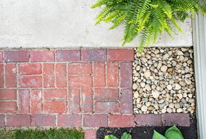 brick walkway next to rocks