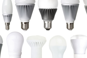 different kinds of LED bulbs lined up on a white background