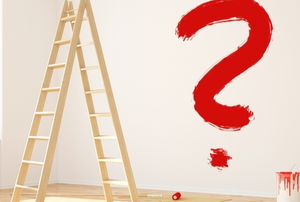an empty room with a ladder and red paint question mark on wall