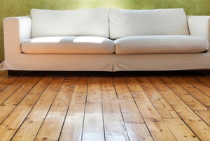 a reclaimed wood floor with a couch