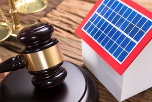small solar house with judicial gavel