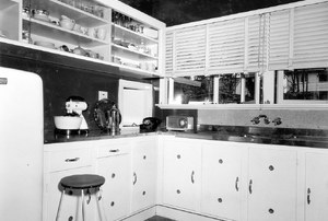 An old home with melamine cabinets.