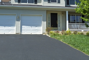 asphalt driveway in front of double garage