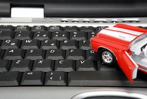 A toy car on a keyboard.