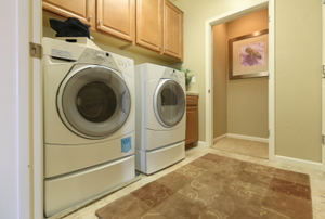 A laundry room with a washer and dryer side-by-side.