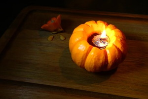 A mini pumpkin olive oil lamp for Thanksgivukkah.
