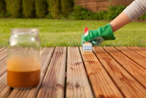 A deck being sealed.