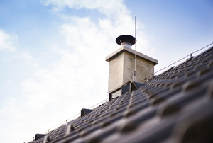 View up a roofline to the chimney