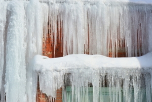 large icicles hanging from the side of a roof