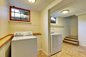 A basement with a washing machine and dryer.