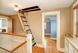 A ladder folding down from an attic door.
