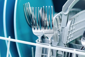 a dishwasher rack with plates and silverware