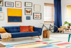 A brightly colored living room with a gallery wall that was done as a snow day project.