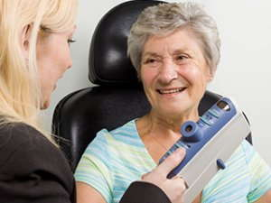 Image of an elderly woman getting a check-up.