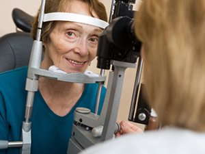 Image of an elderly woman getting an eye exam.