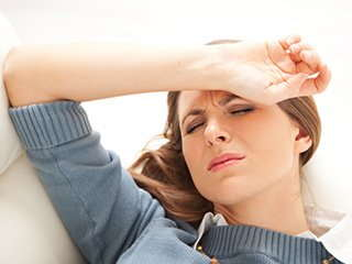 woman closing eyes in pain