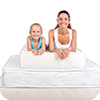 image of people laying on a mattress.