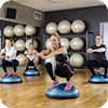 image of people working out on bosu equipment.