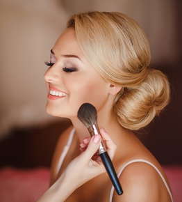 Image of a woman getting her makeup done.