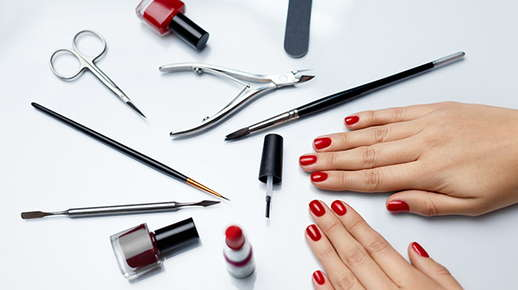 Image of hands next to nail tools.