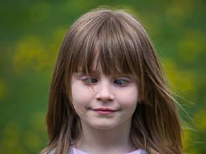 Image of a cross-eyed young girl.