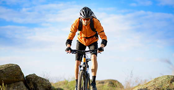 Image of mountain biker wearing protective glasses.