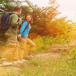 couple hiking on grassy trail